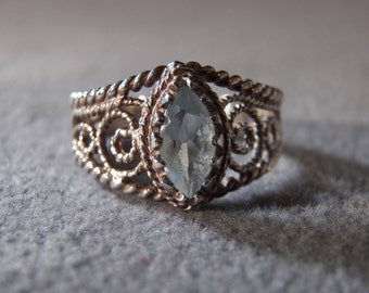 vintage sterling silver fashion ring with large marquise shaped blue topaz ring with rope designed scroll work, size 6