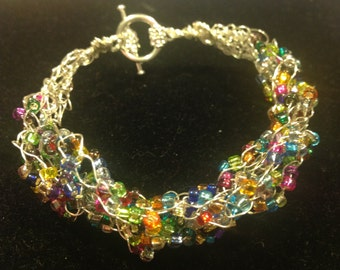 Wire crochet Braclet with bright mulit color blue green red yellow purple orange seed beads