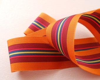 RIBBON:  One yard of grosgrain ribbon in bright orange, 1 1/2 inch wide. Yarn dyed, not printed.