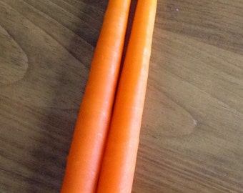 "Carrot orange hand-dipped 10"" taper candle. One pair (2)."