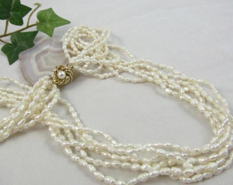 Beautiful  and Eloquent  6 Strand  Lustrous Cream Colored Fresh Water Pearl Twenty Four inch Necklace With Fancy Floral Clasp