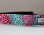 "Adjustable, non-slip headband. 1 inch ""Puff with a Punch""(102)."