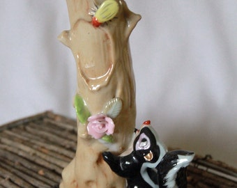 Cute little ceramic skunk bud vase with insect bug