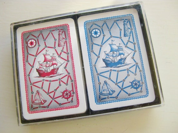 Dale playing cards. Nauticial theme. Red and blue ships, lighthouse and sextant