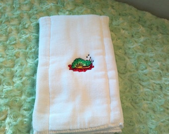 Machine embroidered premium cotton prewashed diaper with a sleeping caterpiller