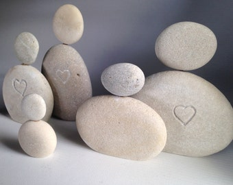 Stone figurines with hearts to give