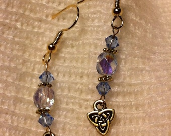 Light blue and gold plated pierced earrings with Celtic charms.