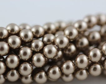 Bronze,6mm Swarovski Crystal Pearl,(5810) pkg of 25  (c-24D-819)