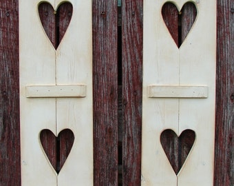 "Decorative hand made wood shutters with 2  hearts in each.  24"" tall and 7"" wide, many colors and size's."