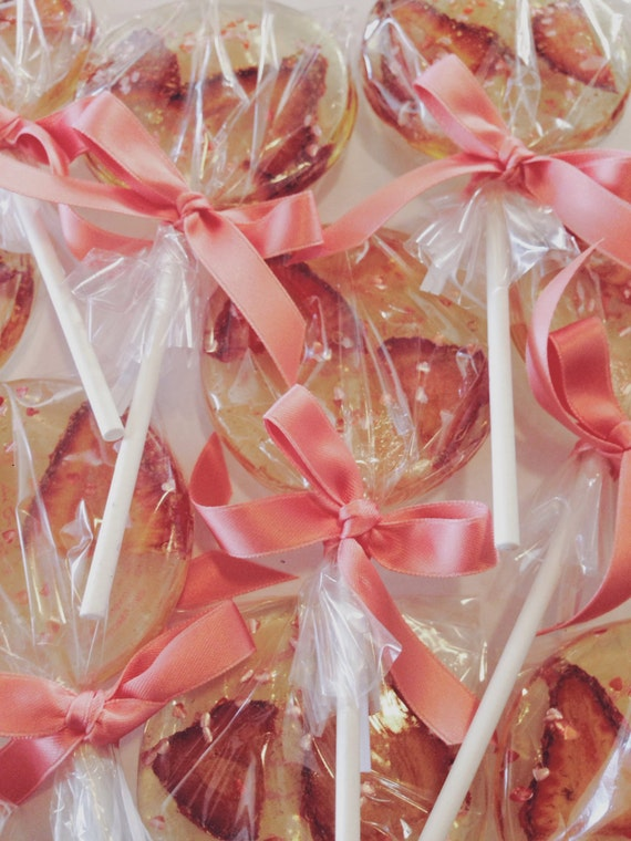 3 Fancy Champagne Flavored Lollipops With Strawberry Slices And Edible Glitter Hearts