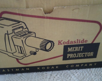 "1950""s Kodak Kodaslide Merit Projector Price Reduction"