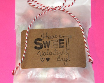 10 Glassine bags with Kraft stamped Valentines Day label and red or pink and white bakers twine for Class treats candy buffet favor party