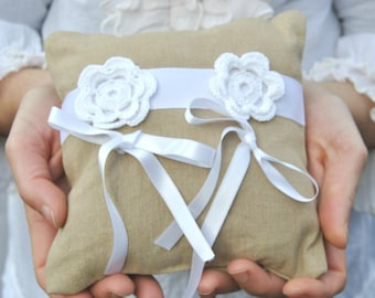 Beige wedding ring cushion with crochet white flowers