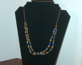 Versatile neutral colored multi-strand necklace