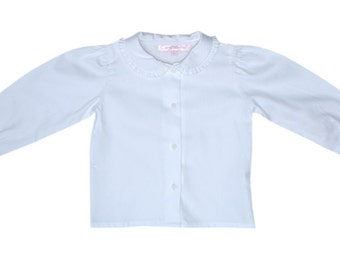 Longsleeve White Shirt. Comfortable shirt. With frills around the Peter Pan collar and cuffs on the sleeves.  Available in all sizes 17505