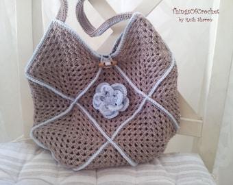 Crochet hand bag with beautiful flower