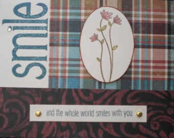 """Card : Reads """"Smile and the world smiles with you"""" and is blank inside. Works well for a masculine card, colors of cocoa, chocolate, juniper"""