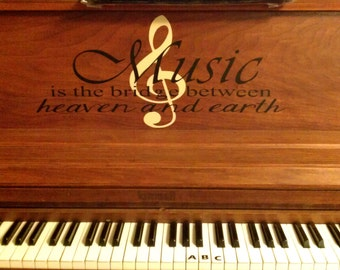 Music is the bridge between heaven and earth piano decal