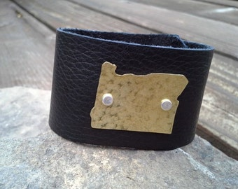 Leather State cuff , hand textured & hand riveted. Can do any state!