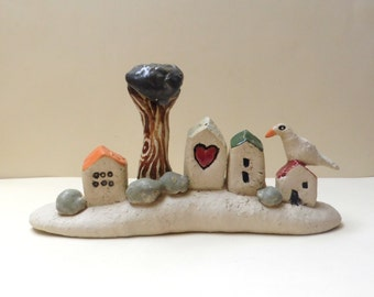 Ceramics sculpture , handmade ceramics and ottery art sculpture of miniature houses , rustic style houses , ceramic bird / naïve Israeli art