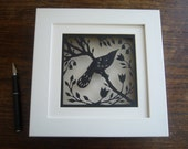 Bird in Spring (black) - Original papercut in white wooden 3D shadow box frame.  Different colour background options available.