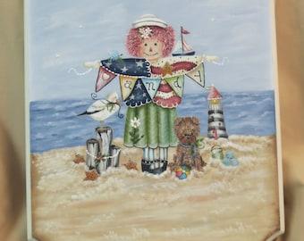 Raggedy Ann at the beach