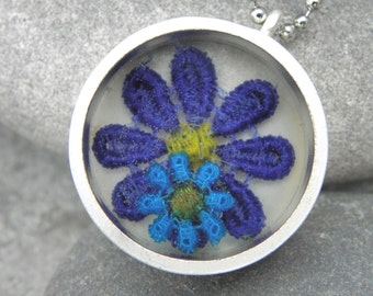 Silver necklace with lace in the colors Purple and turqoise with Epoxy