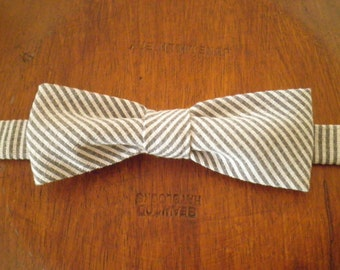 Grey and white striped bow tie