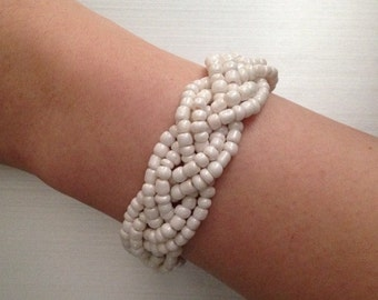 Ivory beads, braided glass bead bracelet