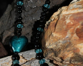 Beautiful blue lampwork heart with black onyx and blue glass beads
