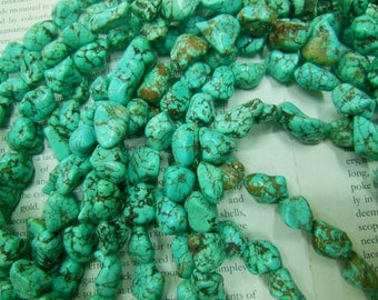 "Turquoise freeform nugget beads, size about 12-15mm, 16"" long."