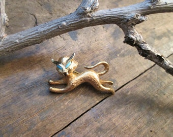 vintage gold tone faux turquoise and black enamel cat eye brooch