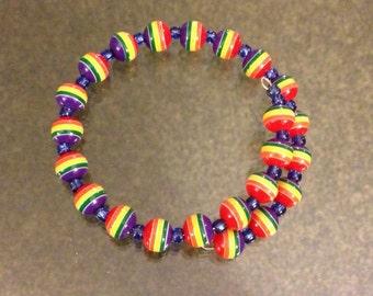 Rainbow bracelet: acrylic beads on memory wire.