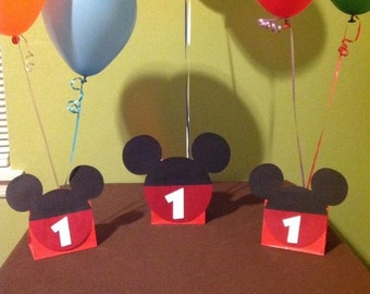 Mickey Mouse balloon centerpieces.  Comes with Child's Age