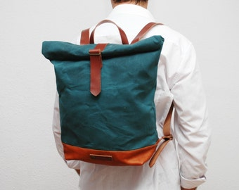 waxed Canvas rucksack/backpack,  atlantic color, hand waxed , with handles, leather base and  closures
