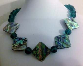 Necklace. 44cm.  Features Paui Abolone Shells. Approximately 2.5 cm in size.
