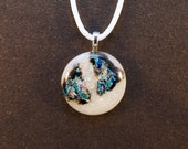 Iridescent white dichroic glass pendant with blue and black accents