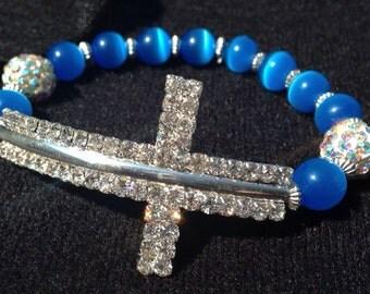 Beautiful eye catching cats eye rhinestone cross bracelet