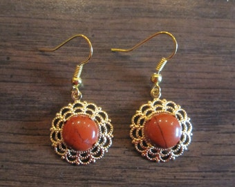 18 mm delicate gold earrings with a 10 mm red jasper stone nestled in the center
