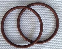 Large Pair of Brown Aluminum sling rings