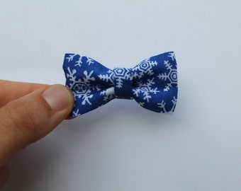 Royal blue with white snowflakes fabric bow on elastic headband, baby girl