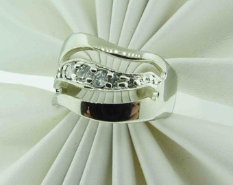 Sterling Silver wave design ring with stones.