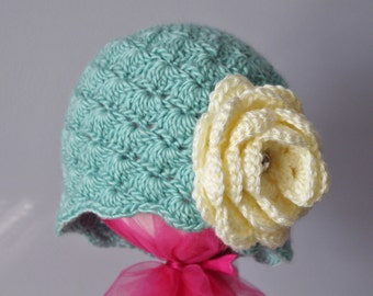 Adorable crochet toddler hat with oversized flower.