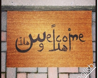 "Multilingual doormat in Arabic / English / French / Italian / Greek / German... mamy languages to choose from to ""Welcome"" you at your door."