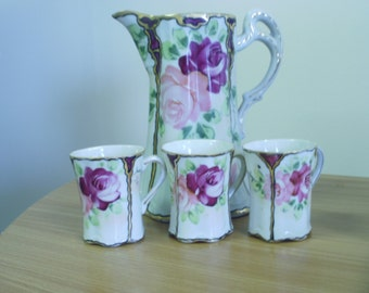 Antique Takita porcelain demitasse hot chocolate pitcher with 3 cups.
