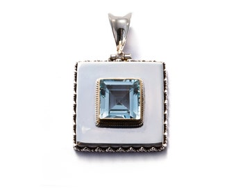 pendant sterling silver and blue topaz with gold plated border