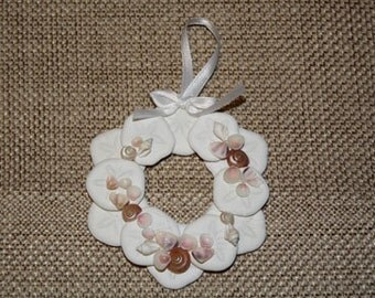 Hand made Natural Sea biscuit wreath with seashells, with white ribbon bow and hanger.