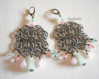 Square filigree earrings and pastel-coloured crystals