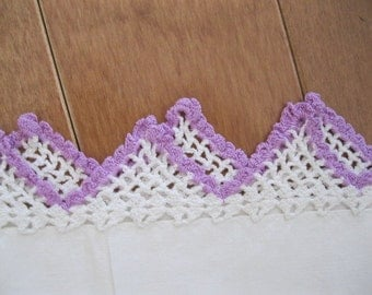 Two hand crocheted pillow cases