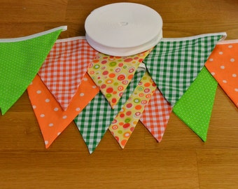 Citrus coloured bunting in oranges and greens, double sided fabric bunting, 10, 15 or 20 flags.